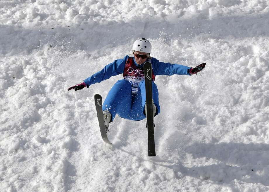 Hanna Huskova of Belarus crashes after a jump during freestyle skiing aerials training at the Rosa Khutor Extreme Park at the 2014 Winter Olympics, Monday, Feb. 10, 2014, in Krasnaya Polyana, Russia. (AP Photo/Andy Wong) Photo: Andy Wong, Associated Press