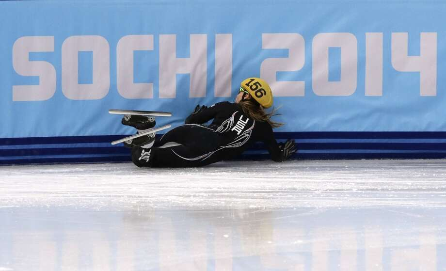 Jessica Smith of the United States crashes in a women's 500m short track speedskating heat at the Iceberg Skating Palace during the 2014 Winter Olympics, Monday, Feb. 10, 2014, in Sochi, Russia. (AP Photo/Bernat Armangue) Photo: Bernat Armangue, Associated Press