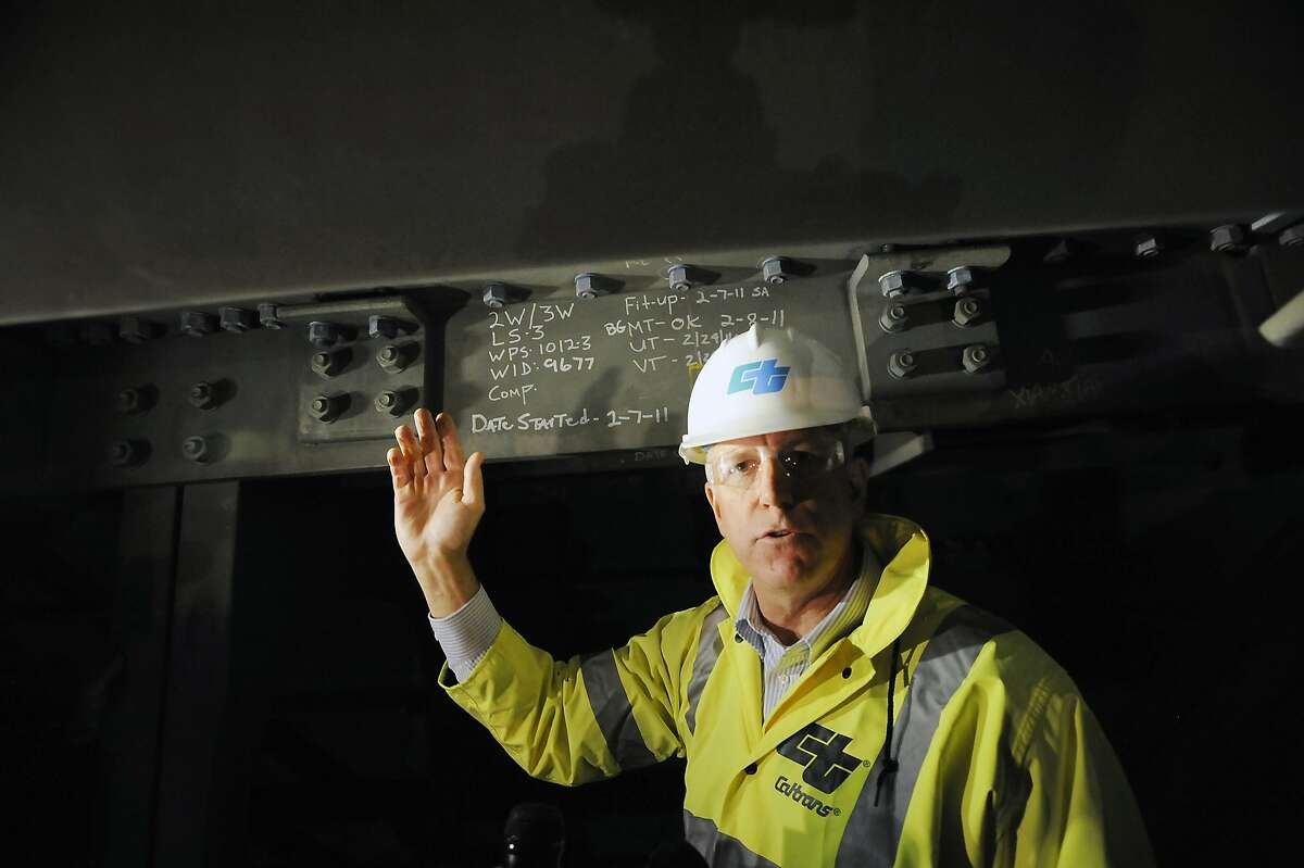 Chief Deputy Director of Caltrans Rick Land, points out where water is leaking from overhead into the hollow steel box girders that make up the roadway of the Eastern span of the Bay Bridge in Oakland, CA Monday, February 10, 2014.