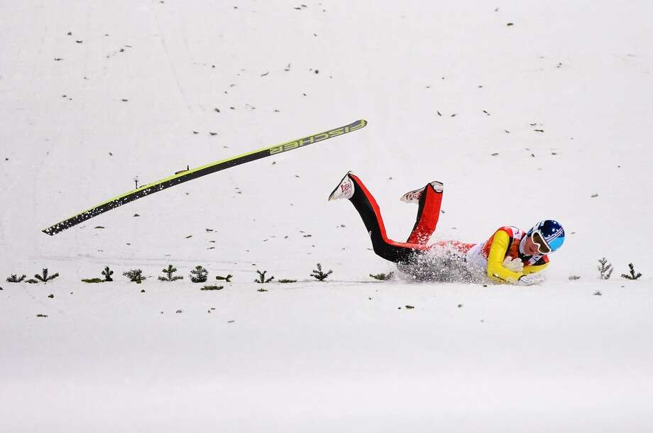 Severin Freund of Germany crashes upon landing during the Men's Normal Hill Individual first round on day 2 of the Sochi 2014 Winter Olympics at the RusSki Gorki Ski Jumping Center on February 9, 2014 in Sochi, Russia.  (Photo by Lars Baron/Getty Images) Photo: Lars Baron, Getty Images