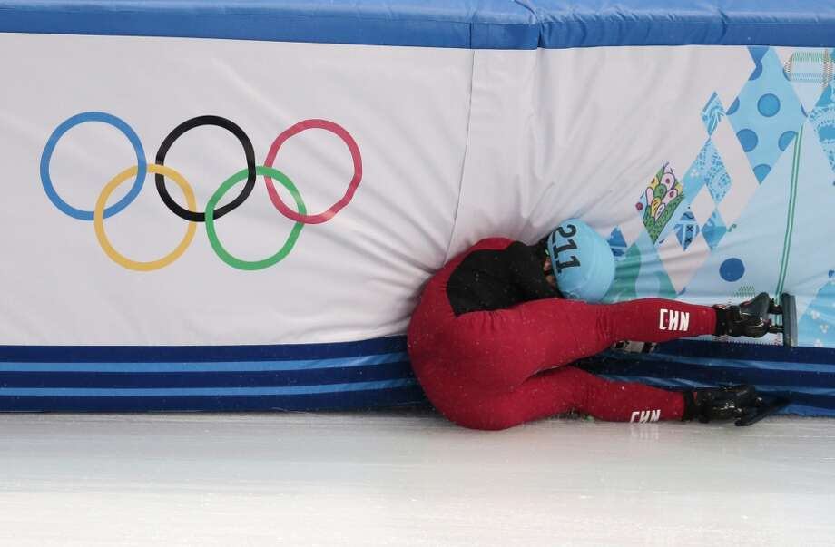 Shi Jingnan of China crashes in a men's 1500m short track speedskating heat at the Iceberg Skating Palace during the 2014 Winter Olympics, Monday, Feb. 10, 2014, in Sochi, Russia. (AP Photo/Ivan Sekretarev) Photo: Ivan Sekretarev, Associated Press