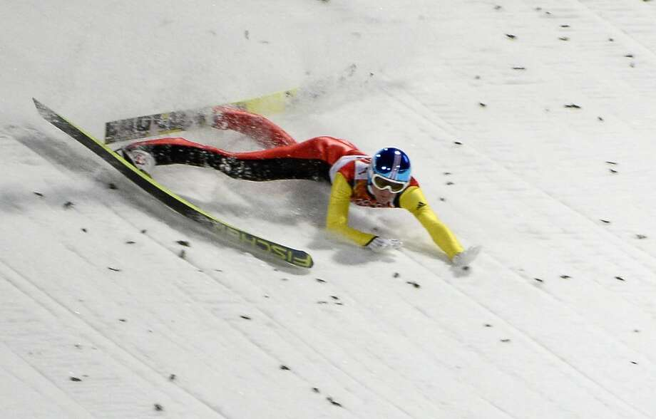 Germany's Severin Freund crashes as he competes in the Men's Ski Jumping Normal Hill Individual Final Round trial at the RusSki Gorki Jumping Center during the Sochi Winter Olympics on February 9, 2014 in Rosa Khutor.  (Pierre-Philippe Marcou/AFP/Getty Images) Photo: PIERRE-PHILIPPE MARCOU, AFP/Getty Images