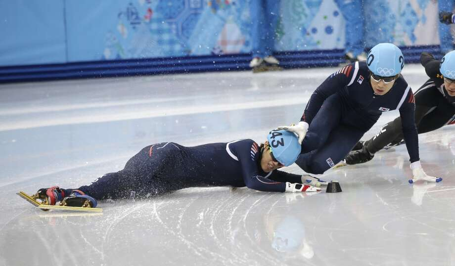 Sin Da-woon of South Korea, left, crashes as Lee Han-bin of South Korea goes down with him in a men's 1500m short track speedskating semifinal at the Iceberg Skating Palace during the 2014 Winter Olympics, Monday, Feb. 10, 2014, in Sochi, Russia. (AP Photo/Darron Cummings) Photo: Darron Cummings, Associated Press