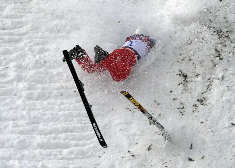 China's Liu Zhongqing crashes during freestyle skiing aerials training at the Rosa Khutor Extreme Park at the 2014 Winter Olympics, Monday, Feb. 10, 2014, in Krasnaya Polyana, Russia. (AP Photo/Andy Wong) Photo: Andy Wong, Associated Press