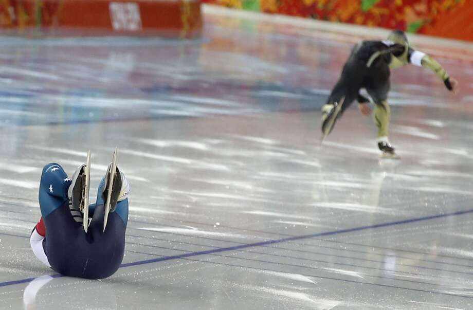 Australia's Daniel Greig, left, crashes in the first heat of his men's 500-meter speedskating race against Yuya Oikawa of Japan at the Adler Arena Skating Center at the 2014 Winter Olympics, Monday, Feb. 10, 2014, in Sochi, Russia. (AP Photo/Pavel Golovkin) Photo: Pavel Golovkin, Associated Press