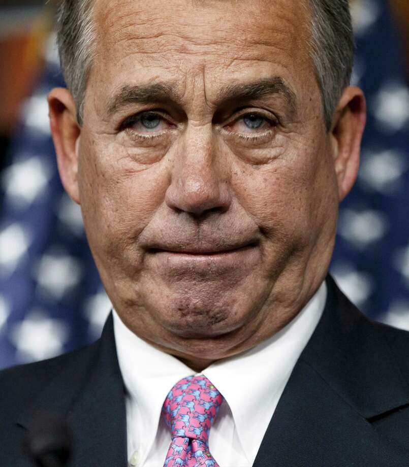 House Speaker John Boehner of Ohio pauses during a news conference on Capitol Hill in Washington, Thursday, Feb. 6, 2014. Boehner said Thursday it will be difficult to pass immigration legislation this year, dimming prospects for one of President Barack Obama's top domestic priorities.  (AP Photo/J. Scott Applewhite) ORG XMIT: DCSA107 Photo: J. Scott Applewhite / AP