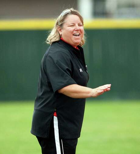 Memorial coach  tina Young during a high school women's softball game between Spring Woods and Memorial Monday, April 27, 2009. The game was suspended due to rain and lighting in the third inning with Memorial winning 3-0. Photo: Bob Levey, Freelance / Freelance