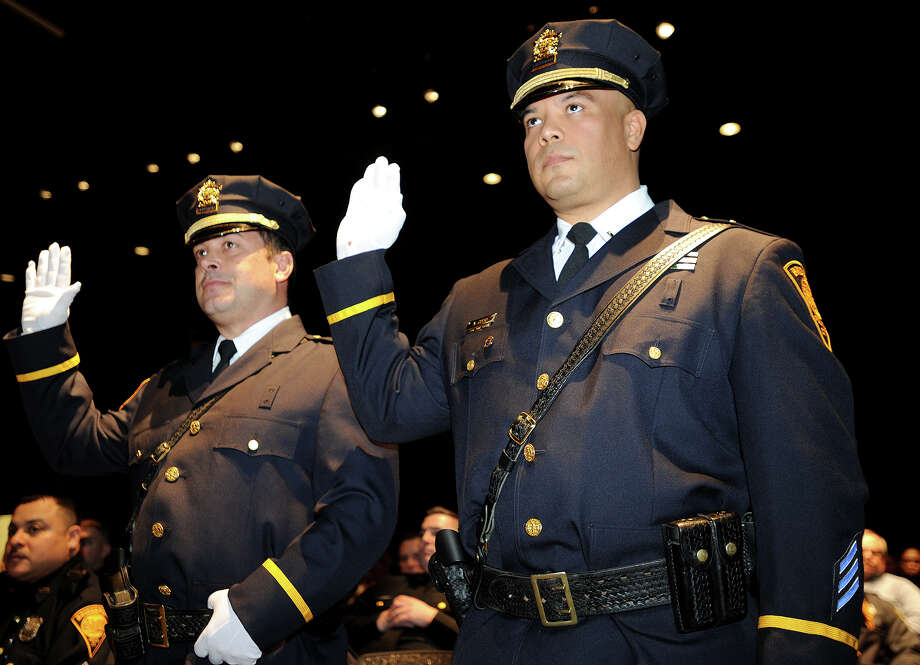 Paul Grech, left, and Manuel Cotto are sworn in during their promotion to the rank of lieutenant at the Bridgeport Police Department's Awards Presentation and Promotional Ceremony at the Fairchild Wheeler Inter-District Magnet School in Bridgeport, Conn. on Monday, February 10, 2014. Photo: Brian A. Pounds / Connecticut Post