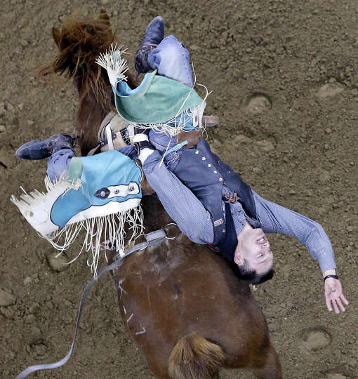 Buck Lunak, of Cut Bank, MT, competes in the bareback riding event during the San Antonio Stock Show