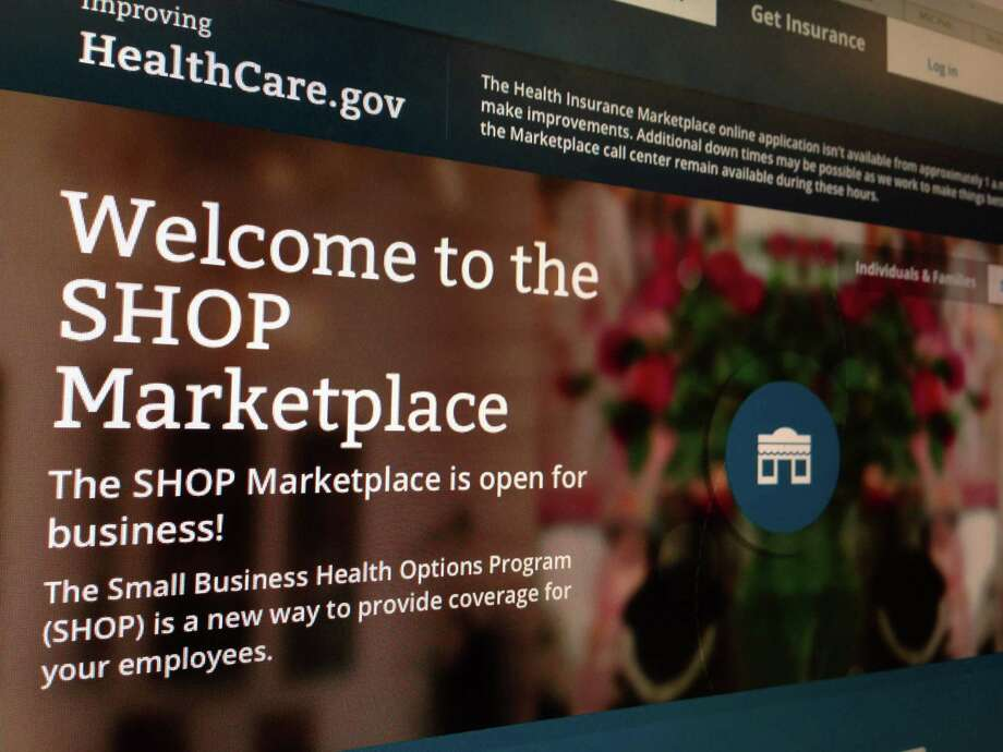 FILE - This Nov. 27, 2013, file photo shows part of the HealthCare.gov website page featuring information about the SHOP Marketplace is photographed in Washington, on Nov. 27, 2013. Trying to limit election-year damage on health care, the Obama administration Monday, Feb. 10, 2014, granted business groups another delay in a much-criticized requirement that larger firms cover their workers or face fines. (AP Photo/Jon Elswick, File) Photo: Jon Elswick, STF / AP