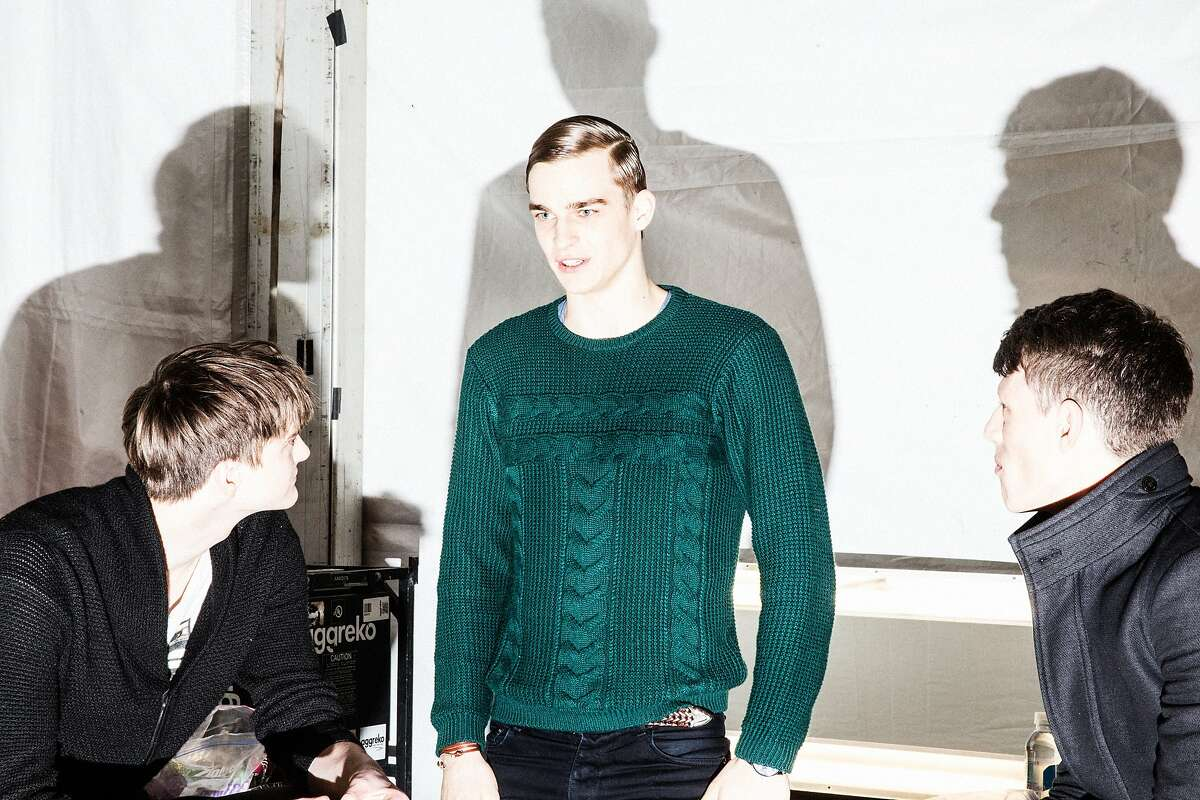 Manhattan, New York - Male models congregate backstage prior to the start of the Academy Of Art University Fall 2014 Collections show during Mercedes-Benz Fashion Week at The Theatre at Lincoln Center in New York City. Friday, February 7, 2014.