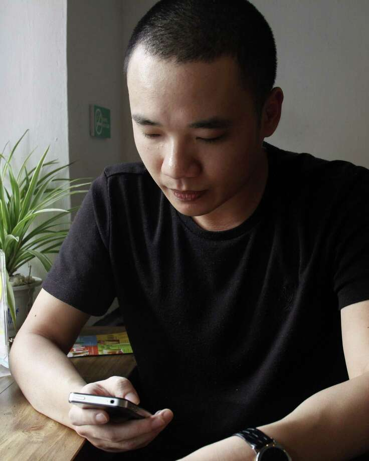"This picture taken on February 5, 2014 shows Nguyen Ha Dong, the author of the game Flappy Bird relaxing inside a coffee shop in Hanoi.  The Vietnamese developer behind the smash-hit free game Flappy Bird has pulled his creation from online stores after announcing that its runaway success had ruined his ""simple life"".  AFP PHOTOSTR/AFP/Getty Images Photo: STR, Stringer / AFP"