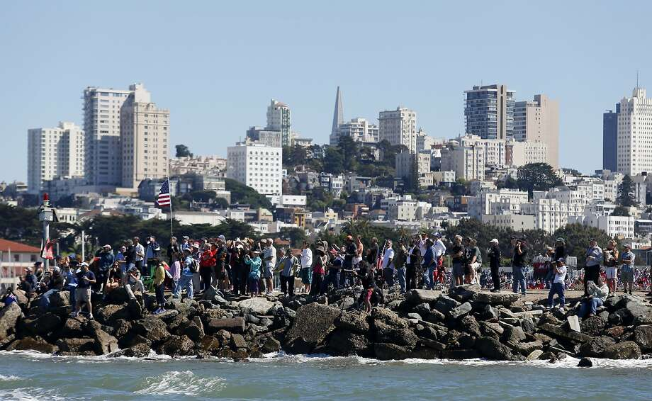 Spectators watch one of the final races of the America's Cup in September. The regatta was won by Oracle Team USA, which is now in the process of choosing the site of the next Cup. Photo: Beck Diefenbach, Special To The Chronicle