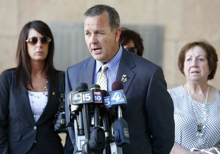 Bob Heyer speaks to the press after the sentencing of Manuel Osorio-Arellanes for the killing of his cousin Brian Terry. Behind him are Terry's sisters Kelly Terry-Willis and Michelle Balogh (partially blocked) and their mother, Josephine Terry. Photo: Mamta Popat / Arizona Daily Star / Arizona Daily Star