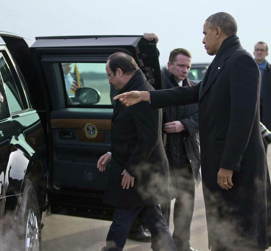 French President Francois Hollande enters President Barack Obama's limousine at the airport in Charlottesville, Va. Photo: Pablo Martinez Monsivais / Associated Press / AP