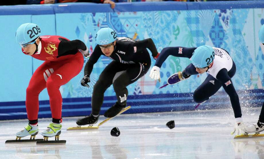 Britain's Jack Whelbourne, right, crashes out behind J.R. Celski of the United States, who finished fourth. Photo: Bernat Armangue, STF / AP