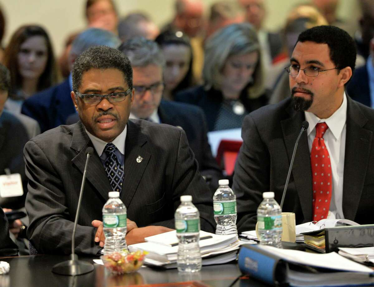 Regent Wade Norwood, left, who headed the Common Core Work Group, and New York State Education Commissioner John King, right, present information on the findings of the group to the Board of Regents Monday morning, Feb. 10, 2014, in Albany, N.Y. (Skip Dickstein / Times Union)
