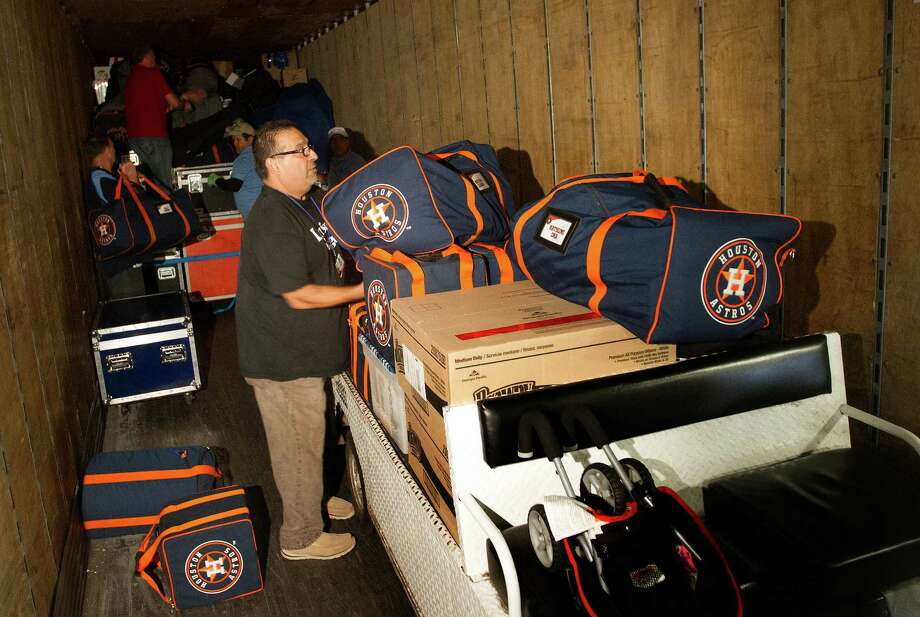 With Carlos Cabrera, foreground, packing a moving van on Monday destined for Kissimmee, Fla., and spring training, the Astros' 2014 season is that much closer to officially getting underway. Photo: Cody Duty, Staff / © 2014 Houston Chronicle