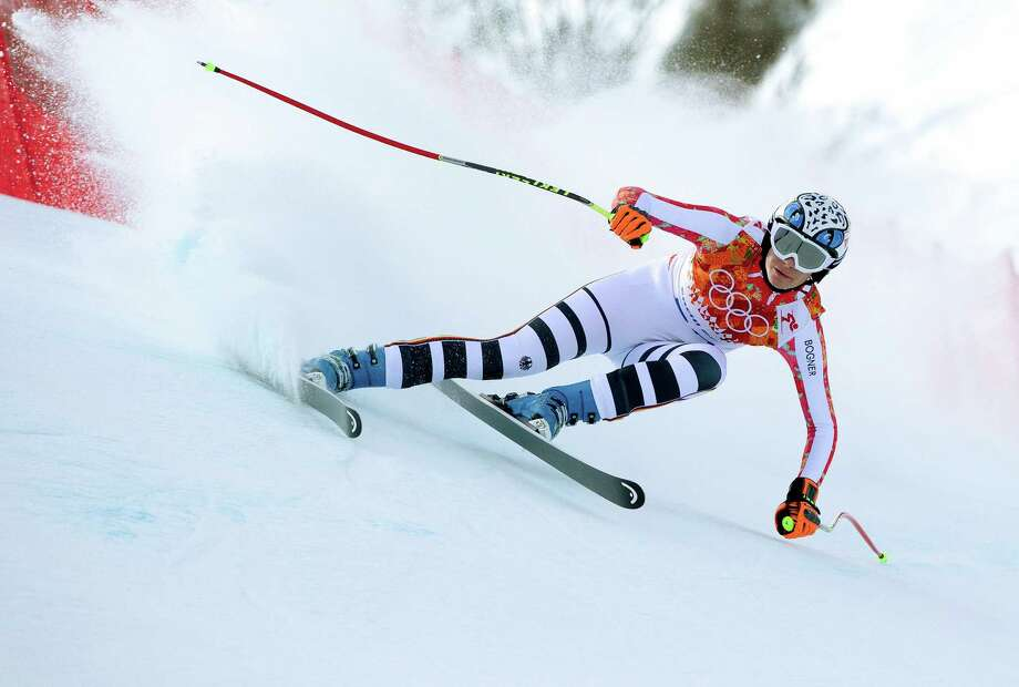 Maria Hoefl-Riesch of Germany heads into a curve during the downhill portion in the women's super combined at the Rosa Khutor Alpine Center during the 2014 Winter Olympics in Krasnaya Polyana, Russia, Feb. 10, 2014. Hoelf-Riesch won the gold medal in the event. (Doug Mills/The New York Times) ORG XMIT: XNYT33 Photo: DOUG MILLS / 30142746A