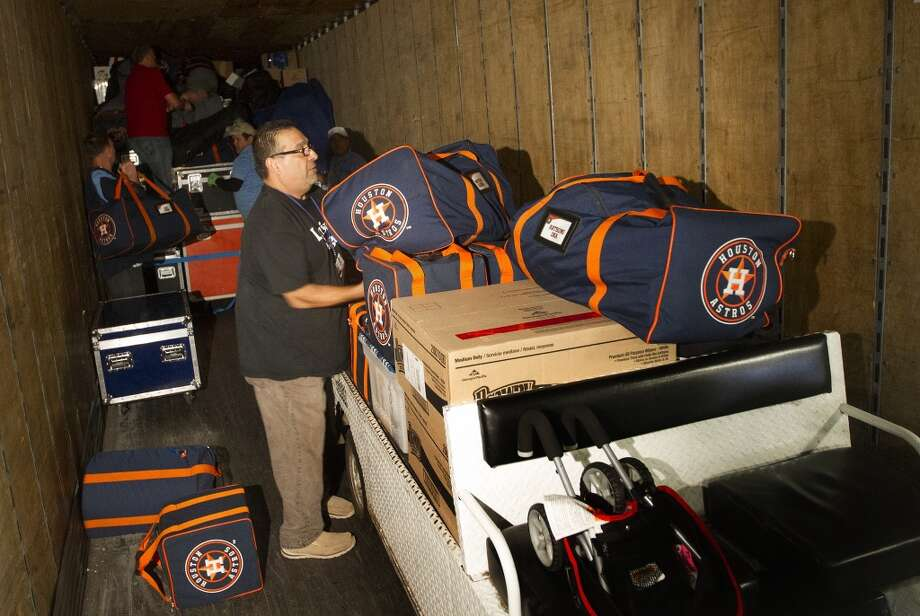 Carlos Cabrera loads Astros bags into a moving trailer at Minute Maid Park on Monday, February. The team is headed to Kissimmee, Florida for spring training. Photo: Cody Duty, Houston Chronicle