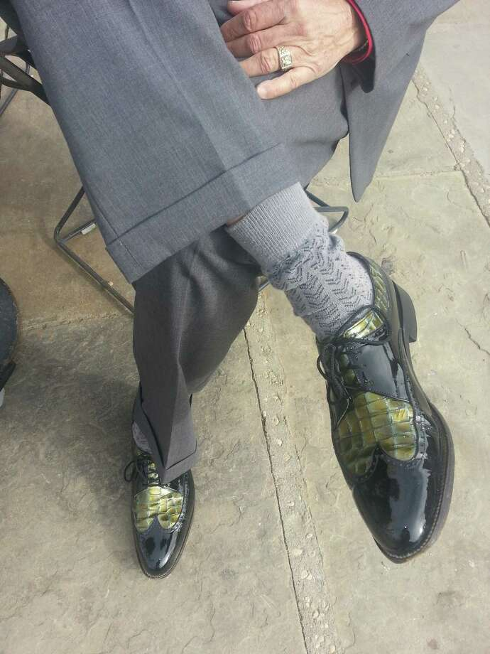 "Sporting a three-piece gray suit and rockin' Stacy Adams shoes, Raul Flores was the most dapper fellow downtown Sunday. ""Penner's is my favorite store,"" he said of the downtown retailer known for its guayaberas and Stacy Adams. Puro San Antonio.