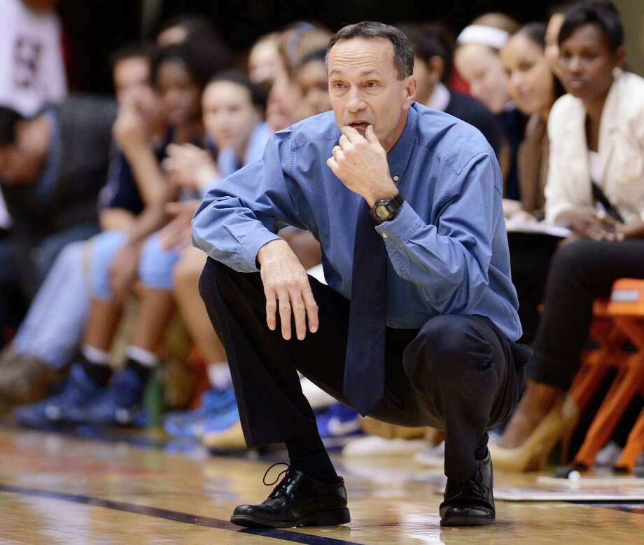 Johnson head coach Randy Evans watches play during a girls high school basketball playoff game against Wagner on Monday, Feb. 10, 2014, at the University of Texas at San Antonio. (Darren Abate/For the Express-News) Photo: Photo By Darren Abate/Express-News