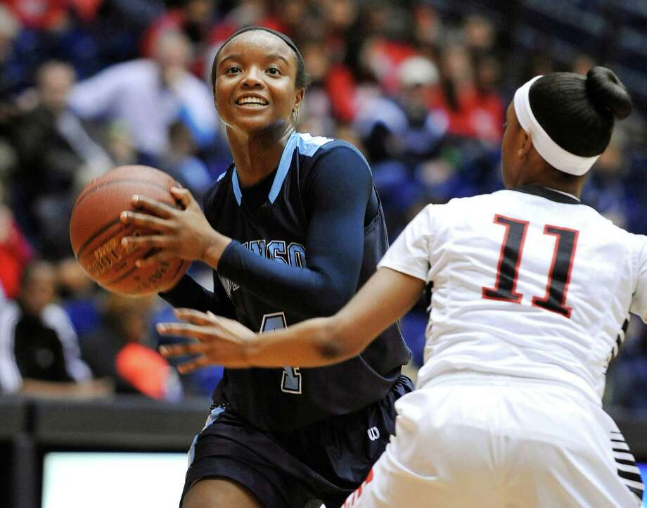 Johnson's Gabbi Bowie, left, looks to shoot against Wagner's Desierre Johnson during a girls high school basketball playoff game on Monday, Feb. 10, 2014, at the University of Texas at San Antonio. (Darren Abate/For the Express-News) Photo: Photo By Darren Abate/Express-News