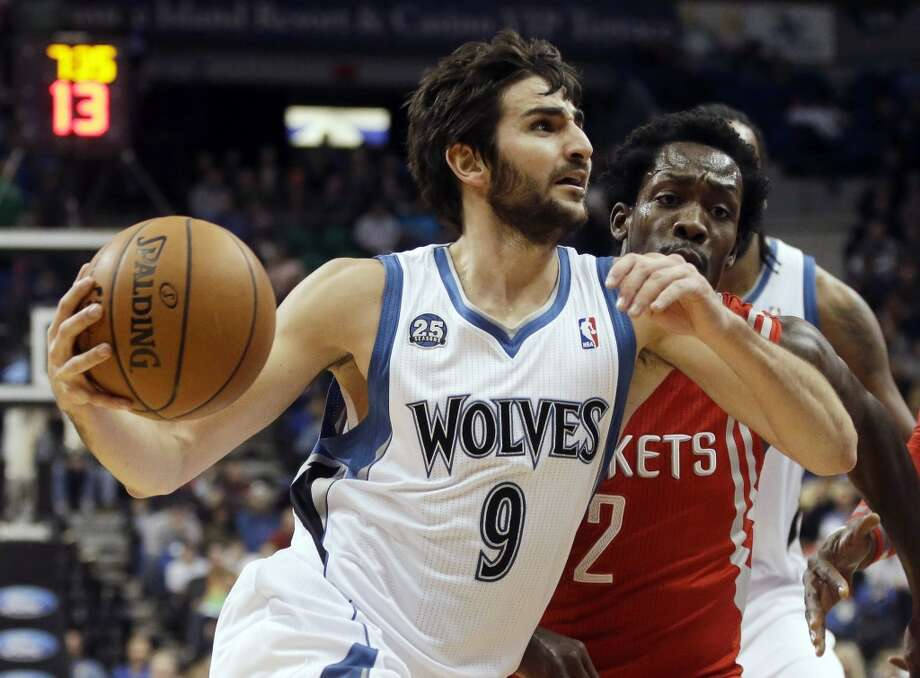 Feb. 10: Rockets 107, Timberwolves 89  Rockets point guard Pat Beverley defends Ricky Rubio of the Timberwolves. Photo: Jim Mone, Associated Press