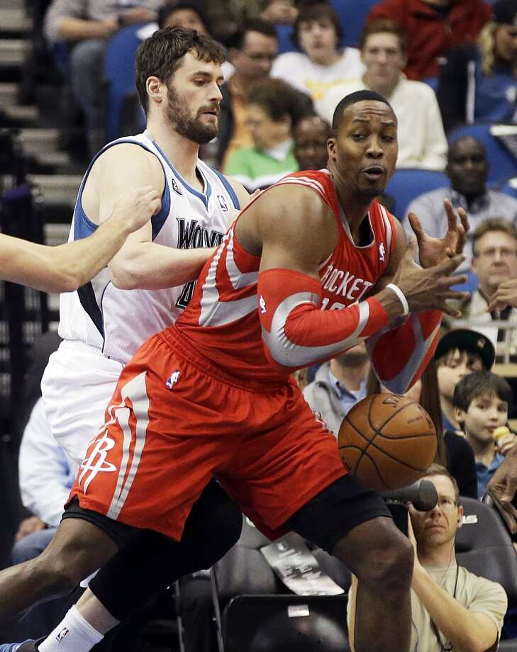 Rockets center Dwight Howard loses possession against the Timberwolves. Photo: Jim Mone, Associated Press