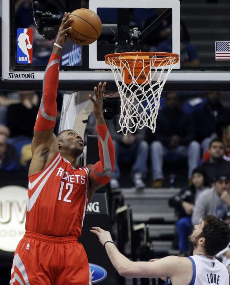 Rockets center Dwight Howard attempts a shot against the Timberwolves. Photo: Jim Mone, Associated Press