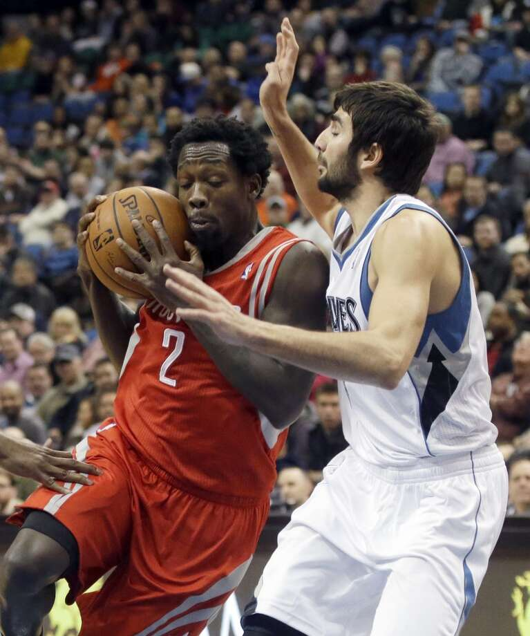 Pat Beverley of the Rockets is defended by Timberwolves point guard Ricky Rubio. Photo: Jim Mone, Associated Press
