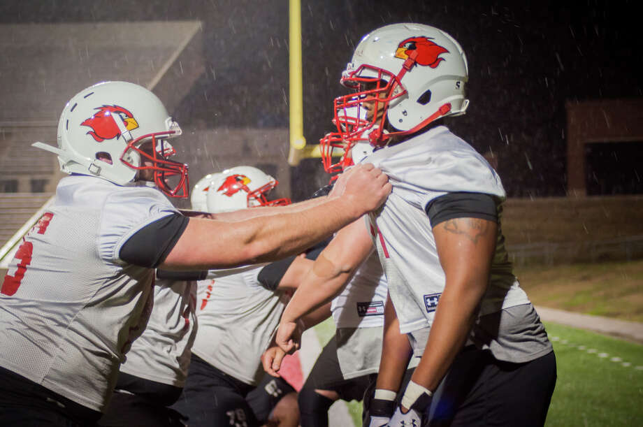 The Lamar University Cardinals trained during the first practice Monday night at the Provost Umphrey Stadium Photo: Michael Reed / Michael Reed