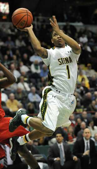 Siena's Marquis Wright goes up for a shot during a basketball game against Fairfield at the Times Un
