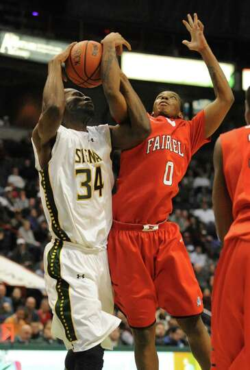 Siena's Imoh Silas battles for the ball with Fairfield's Justin Jenkins during a basketball game at