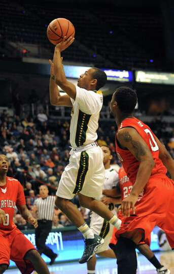 Siena's Evan Hymes goes up for a shot during a basketball game against Fairfield at the Times Union