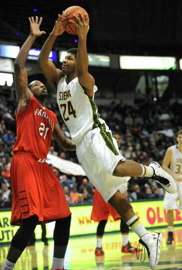 Siena's Lavon Long is guarded by Fairfield's Amadou Sidibe during a basketball game at the Times Uni