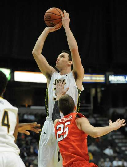 Siena's Brett Bisping goes up for a jump shot during a basketball game against Fairfield at the Time