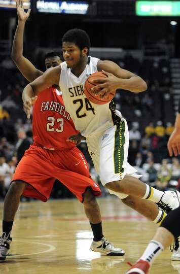 Siena's Lavon Long is guarded by Fairfield's Steve Johnston during a basketball game at the Times Un