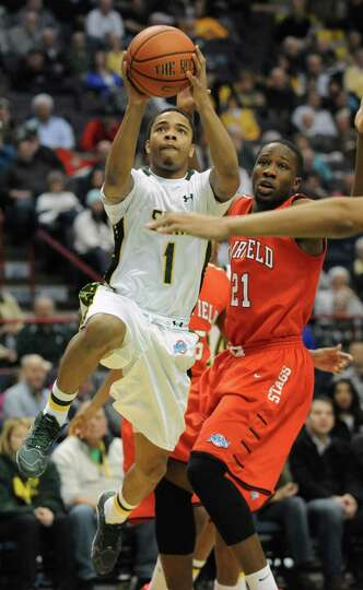 Siena's Marquis Wright goes up for a layup during a basketball game against Fairfield at the Times U