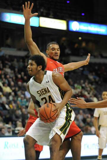Siena's Lavon Long is guarded by Fairfield's Malcolm Gilbert during a basketball game at the Times U