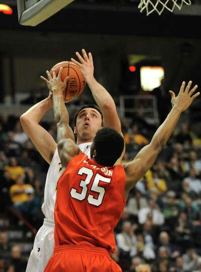 Siena's Brett Bisping is guarded by Fairfield's Coleman Johnson during a basketball game at the Time