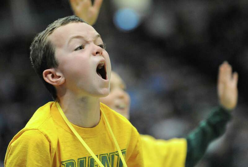 Siena court cleaner and fan Jeffrey Maddalone, 9, of Clifton Park yells for a free shirt during a ba