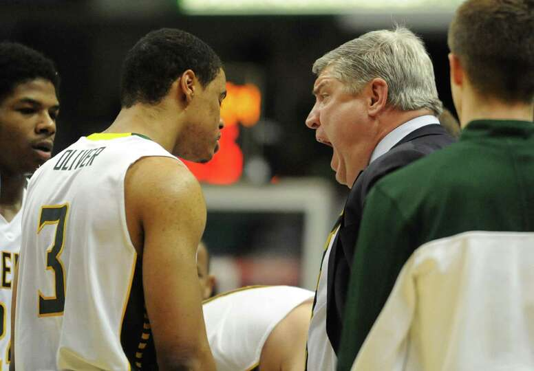 Siena coach Jimmy Patsos yells at Ryan Oliver at a time out during a basketball game against Fairfie