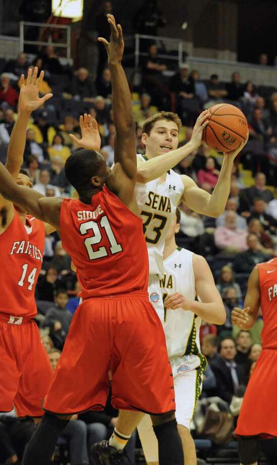 Siena's Rob Poole is fouled by Fairfield's Amadou Sidobe as he tries to pass the ball during a basketball game at the Times Union Center Monday, Feb. 10, 2014 in Albany, N.Y.   (Lori Van Buren / Times Union) Photo: Lori Van Buren / 00025639A