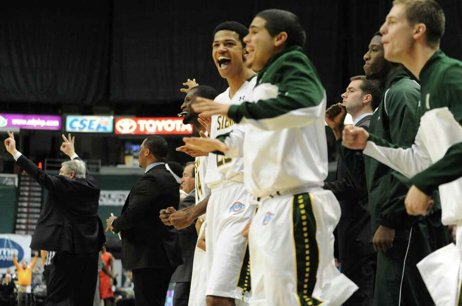 The Siena bench jumps with joy as their team takes the lead with minutes left in the second half during a basketball game against Fairfield at the Times Union Center Monday, Feb. 10, 2014 in Albany, N.Y.   (Lori Van Buren / Times Union) Photo: Lori Van Buren / 00025639A