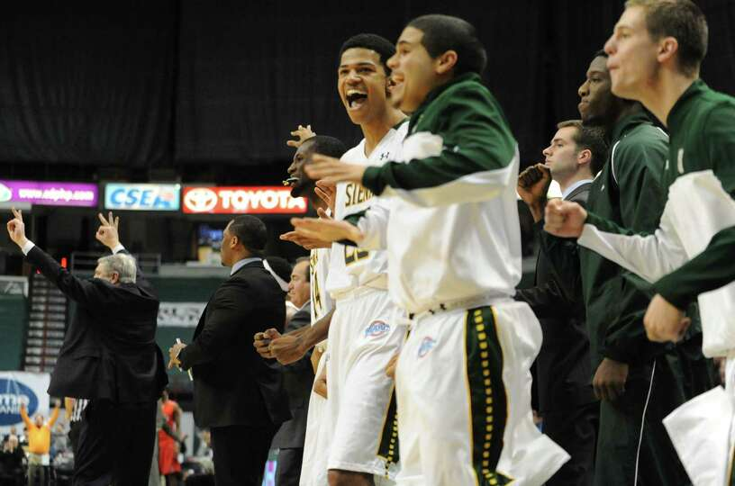 The Siena bench jumps with joy as their team takes the lead with minutes left in the second half dur
