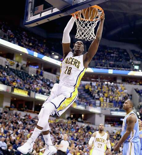 Former seldom-used Spurs center Ian Mahinmi shows some hang time on a dunk during the Pacers' 119-80 rout of the Nuggets at Bankers Life Fieldhouse. Photo: Andy Lyons / Getty Images / 2014 Getty Images