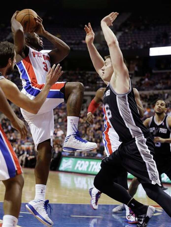 Detroit Pistons guard Rodney Stuckey (3) shoots over San Antonio Spurs forward Aron Baynes (16) during the second half of an NBA basketball game in Auburn Hills, Mich., Monday, Feb. 10, 2014. (AP Photo/Carlos Osorio) Photo: Carlos Osorio, AP / AP