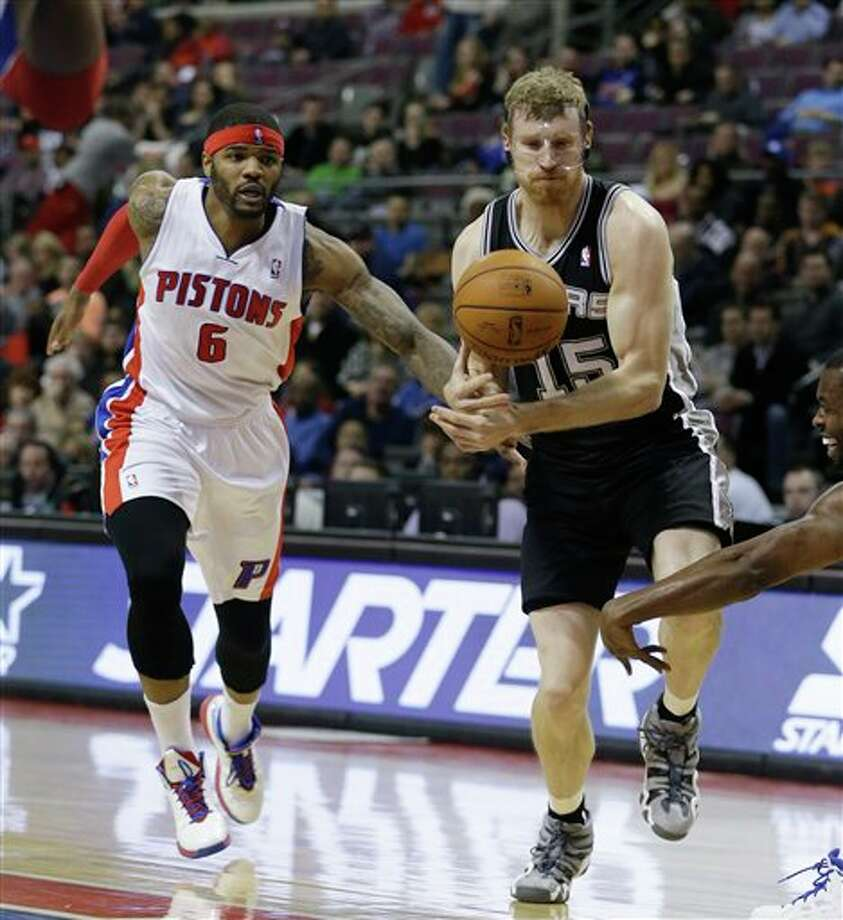 San Antonio Spurs forward Matt Bonner (15) bobbles the ball next to Detroit Pistons forward Josh Smith (6) during the first half of an NBA basketball game at the Palace of Auburn Hills, Mich., Monday, Feb. 10, 2014. (AP Photo/Carlos Osorio) Photo: Carlos Osorio, AP / AP