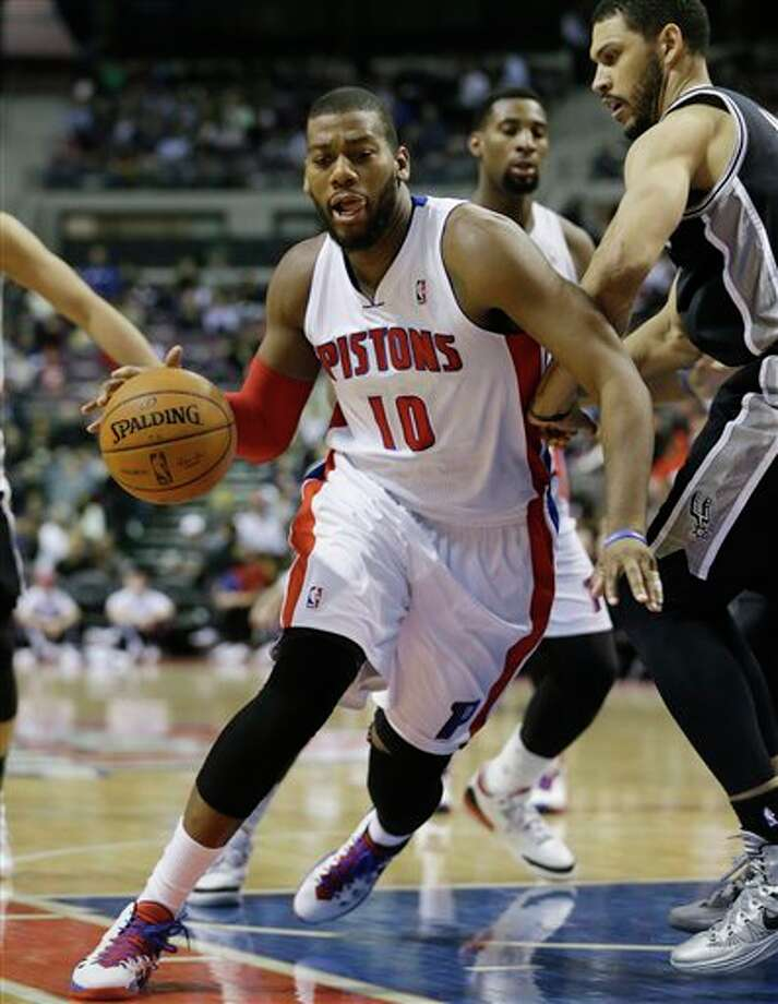 Detroit Pistons forward Greg Monroe (10) drives during the second half of an NBA basketball game against the San Antonio Spurs at the Palace of Auburn Hills, Mich., Monday, Feb. 10, 2014. (AP Photo/Carlos Osorio) Photo: Carlos Osorio, AP / AP
